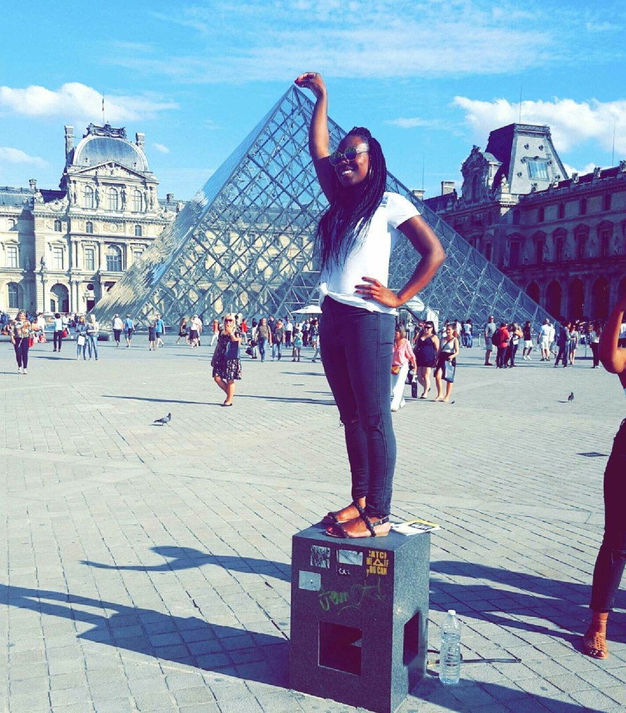 Month 8. Simone at the Louvre Pyramid in Paris.