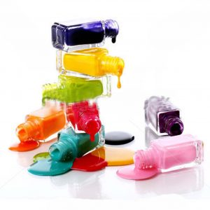 stock-photo-bottles-with-spilled-nail-polish-over-white-background-92782549
